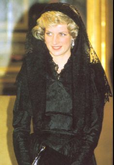 Diana meets His Holiness Pope John Paul II at the Vatican in the traditional black mantilla.