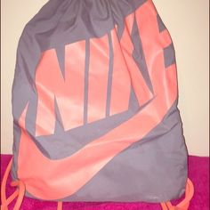 Nike drawstring gym bag Pink and gray Nike drawstring gym bag. Does show light wear on the swoosh. Nike Bags Backpacks