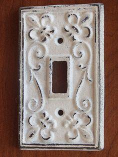 Antique White Light Switch Cover / Light Plate Cover / Cast Iron / Wall Decor / Fleur de lis Pattern. $8.99, via Etsy.