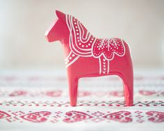 I love Dala Horses! I have two of them; red and white. It would be great to get more :)
