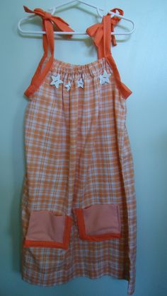 Orange pillowcase dress. The pockets are actually from a reallly old muslin pillowcase.