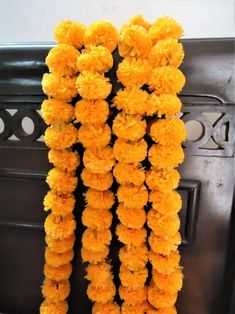 Item Specification:  Item - Indian Artificial Handmade Marigold Flower Garlands, Strings  Size - 4.5 Feet Approx  Color - Mango color ( As Shown In Image )  Packing - As Per Lot Selection.  Technique - Cotton Flower With Mirror Work Embellish  Item Description:  Original looking artificial blue flowers, Mirror Work strings for party decorations.For decoration of wedding,party,home, office or any festive event public place.. Light in weight. Gently rub the garland to get the Fresh.