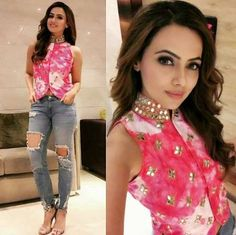 Imaginative Indo-western. Sana Khan looks amazing in this Indo-western look with the very smart top with mirror work and a tie dye print. The classic ripped jeans are perfect with this top.  https://www.estrolo.com/whatstrending/cat/celeb-style/ #pink #mirrorwork #denim #blue #SanaKhan #EstroloFashion