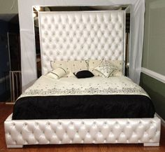 * * *This exquisite bed has been sold however, we can make you a custom one just like it* * *  This bed is as luxurious as can be. I have listed a few heights and sizes however, it can be made in any size and height desired.  The bed pictured is: king size, 7 high, upholstered in a gorgeous ivory faux-leather. It has a rhinestone in each tuft.  PRICE IS ALL INCLUSIVE - INCLUDES FABRIC OR FAUX-LEATHER AND SHIPPING  Listing is for upholstered bed and rails as pictured; mattress and box spring…