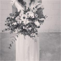 Silk wedding dress + white flowers. Best couple.