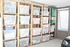 Tote storage shelving made from wood  Could use wood pallets for base