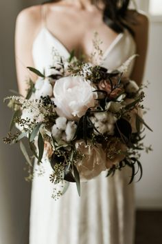 The Acreage Calgary Wedding Inspiration // Dark & Classic via Rocky Mountain Bride // ivory natural and organic bridal bouquet // cotton, peonies, roses, astilbi, seeded euc // @greylilyphoto @ruedeseinebride Fall for Florals @bridal_boutique