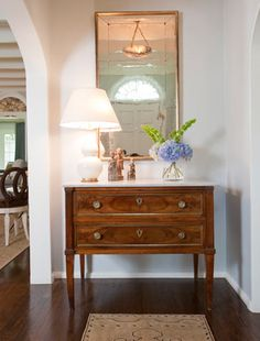 Beautiful antique commode with modern lamp.