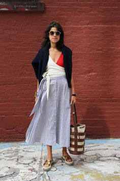 The Hesse Bucket in Papyrus featured in the story: Your Beach Look in a Tiny Tote on Man Repeller