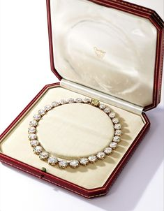 Bunny Mellon Diamond Riviere An Exquisite Gold and Diamond Rivière, Cartier Late 1940's – Of graduated design, set with 29 old European-cut diamonds weighing approximately 111.00 carats, completed with a clasp set with a round Fancy Deep Yellow diamond weighing 4.20 carats (Estimate $1.25/1.5 million) – Photo courtesy of Sotheby's