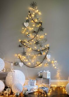Lights, garland, a few ornaments and a chalkboard tree drawn on the wall.
