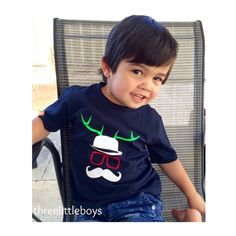 "Cutie pie petit Logan in our ""Sven"" design from @threelittleboysclothing  Check them out! They stick the cutest threads  #momes#mômes#organic#stockist#wholesale#deer#reindeer#xmas#gift"
