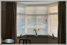 21d9c246403 Cool White Wooden Blinds in a Bay Window