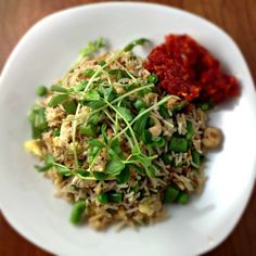 Cashew Fried Rice    ½ cup raw unsalted cashews  1 handful green beans, tipped and tailed, cut into 1″ pieces  1 handful snap peas, de-stringed, cut in half  ¾ cup frozen peas, thawed  Canola oil  2 garlic cloves, minced  2-inch piece of peeled ginger, minced  About 4 cups cooked cold rice (I used basmati)  1-2 tbsp. soy sauce  2 eggs, beaten  1 tsp. toasted sesame oil  Green sprouts of any kind, for garnish (optional)  Chile Tomato Jam