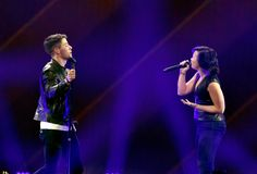 Nick Jonas and Demi Lovato perform onstage during KIIS FM's Jingle Ball 2014 powered by LINE at Staples Center on December 5, 2014 in Los Angeles, California.