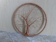 I made this wall hanging using 14 guage copper wire wrapped around a $2 ebroidery frame.