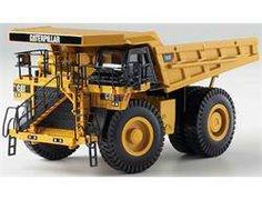 Caterpillar Mining Dump Truck Features include: Truck bed raises and lowers Wheels that roll with authentic tread design Power Edge and nomenclature deco Grab bars ladders and authentic trim detail Clear windows with interior ca<li>Age: 14 and up Dump Truck, Truck Bed, Play Vehicles, Hydraulic Cylinder, Bike Photo, Model Airplanes, Heavy Equipment, Scale Models, Diecast