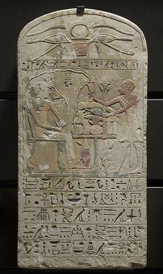 La dame Hénout recevant une offrande  vers 1400 avant J.-C.  calcaire H. : 57,50 cm. ; L. : 29 cm. ; Pr. : 5,50 cm.  Don Mallet Département des Antiquités égyptiennes E 17402