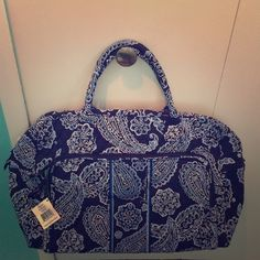 "Vera Bradley Weekender Travel Bag in Blue Bandana Vera Bradley Weekender Travel Bag in Blue Bandana. Brand new with tags!                                    Dimensions:18 ½"" W x 12 ½"" H x 8"" D with 6 ½"" strap drop and 48 ½"" adjustable, removable strap Vera Bradley Bags Travel Bags"