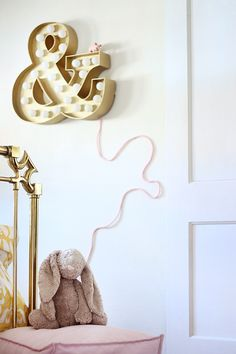 DIY Gold Glitter Marquee Light with yarn wrapped cord – Looks so cute in this little girl's room! #diy