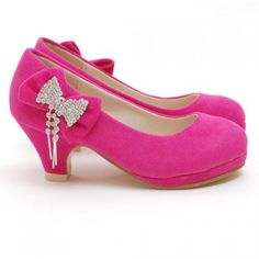 $23.99 - Darling yet trendy faux fuchsia suede platform shoe is just perfect for your stylish little girl by Link.  These faux suede platform low heel shoes feature a jewel accented bow on side.  These shoes would be great with skirts, dresses or fun leggings.