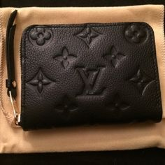 Louis Vuitton Zippy Coin Purse Monogram Empreinte This has been used a few times, but is not showing signs of wear. See photos and ask questions, please. This is a beautiful, versatile piece for those who are compact. NO TRADES / NO PAYPAL / NOT ELIGIBLE  FOR BUNDLE DISCOUNT MSRP $660 (w/ tax) 4.3 x 3.1 inches (Length x Height)  - Four credit card slots - 1 business card slot  - Two large coin compartments  - 2 pockets for bills and received - Embossed calf leather with smooth calf leather…