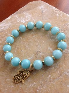 Amazonite bracelet with Hamsa Hand charm. $18.00, via Etsy., an arabic jewerly meaning good luck and to keep harm away, I have one myself just beuatiful!