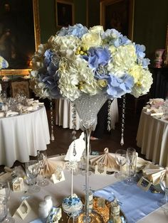 Wedding Martini Glass Centrepiece in pale blue and ivory, filled with stunning hydrangeas, berries, roses, spray roses and lisianthus www.entirelybridal.co.uk www.facebook.com/entirelybridal