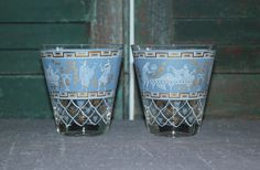 Pair of blue Hellenic Greek Roman glasses with gold highlights. Would make a fabulous addition to your home bar. Measures 4 tall and 4 across top.