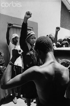 """Winnie Mandela Raising Fist at Funeral Winnie Mandela, wife of imprisoned African National Congress leader Nelson Mandela, does the """"Amandla"""" salute during the funeral of one of her murdered supporters in Brandfort, South Africa. Mandela had been."""
