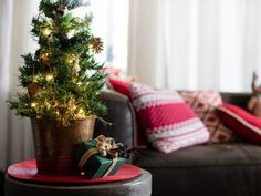To dress up this 18-inch tabletop tree, everyday items and organic outdoor objects were transformed into holiday decor. Get quick tips on how you can recreate the look on your own miniature tree, too!
