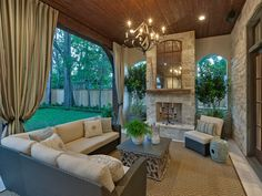 Outdoor room/porch with rustic French neutral overtones; Houston.