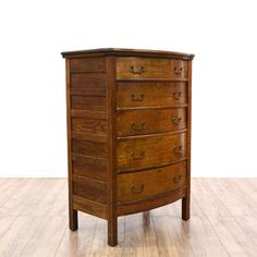 This antique highboy dresser is featured in a solid wood with a gorgeous quarter sawn oak finish. This tall dresser has 5 spacious drawers, carved panel sides and a curved front. Stunning vintage storage piece perfect for additional closet space! #countryfarmhouse #dressers #talldresser #sandiegovintage #vintagefurniture