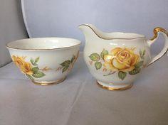 Crown Regent  milk jug and sugar bowl  roses decoration