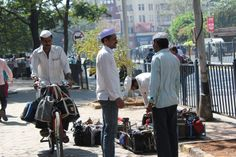 The Dabbawalas at work near Churchgate Station, Mumbai, India
