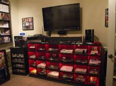 I want this to be my life.  except it needs full DVD shelves surrounding the tv.