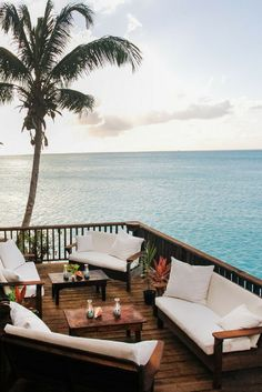Think cosy cocktails overlooking the azure sea in Antigua