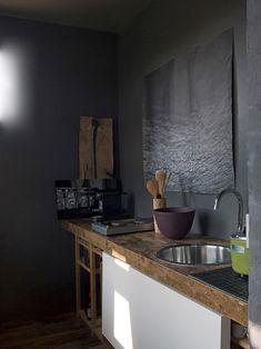 Utility room, chunky wood, dark walls -  Max Zambelli -darkness.