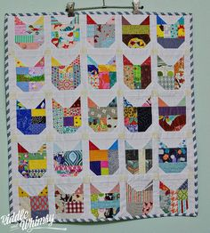 Memory cat quilt - each cat represents a quilt she made