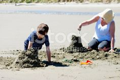 Grandmother and Grandchild build Sandcastles royalty-free stock photo
