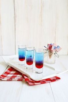 Whether you fill shot glasses with these yummy Bomb Pop Shots, found via @elsiecake, or switch them out for a layered red, white, and blue Patriotic Jello Dessert, have a little fun styling your 4th of July menu. http://thestir.cafemom.com/home_garden/185942/12_stylish_ways_to_decorate