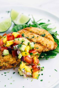 Grilled Tequila Lime Chicken with Mango Salsa - the ultimate quick and easy recipe for warm summer nights. Each honey lime glazed chicken is topped with fresh mango salsa. | jessicagavin.com
