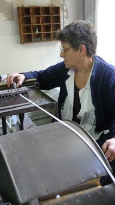Atelier Boutique Legeron. Cotton is heated and rolled to make the piping for the stems.