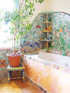 amazing mosaic made with recycled bottles and broken china. I COULD BREAK UP A FEW WINE BOTTLES! THAT COULD BE THE BASE?!