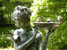 The Secret Garden. Burnett Fountain Conservatory Garden, New York. This statuary fountain stands in the center of the Conservatory Garden's South Garden, a memorial tribute to Frances Hodgson Burnett, author of the children's classics The Secret Garden (1909).