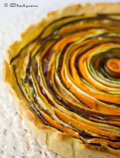 Vegetable Arty Tart. This a almost too pretty to eat. The veggies are eggplant, carrot and zuchinni. I don't know if I'd ever have the patience to make this but what a showpiece it would make on a dinner table