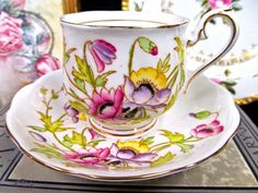 OFFERING THIS PRETTY JUST FANTASTIC TEA CUP AND SAUCER THIS WAS MADE IN ENGLAND BY ROYAL ALBERT. ........................................................... THIS SITS ON A FOOTED BASE HAS A FANCY HANDLE THIS HAS NO WEAR AND NO FADING AND NO CRAZING, SUPER PIECE, PAINTED FLOWERS AND
