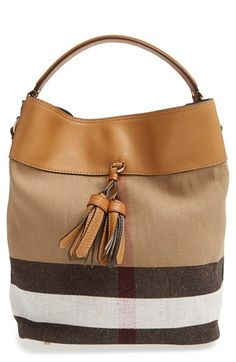 """Free shipping and returns on Burberry 'Medium Ashby' Bucket Bag at Nordstrom.com. <p><B STYLE=""""COLOR:#990000"""">Pre-order this style today! Add to Shopping Bag to view approximate ship date. You'll be charged only when your item ships.</b></p><br>Color-saturated leather trim and dual tassels add a refined, modern twist to a favorite bucket bag styled with signature oversized checks."""