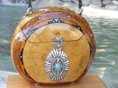 Southwestern gourd purse with tourquoise buckle, soft black leather lined in two-tone brown colors