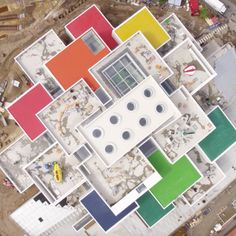 Lego has flown a drone camera over its BIG-designed visitor centre in Billund, Denmark, capturing its stacked-block formation.